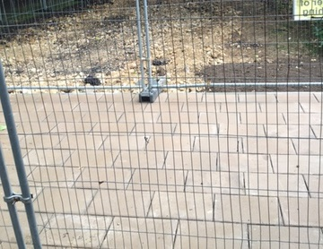Block paving with protective fence